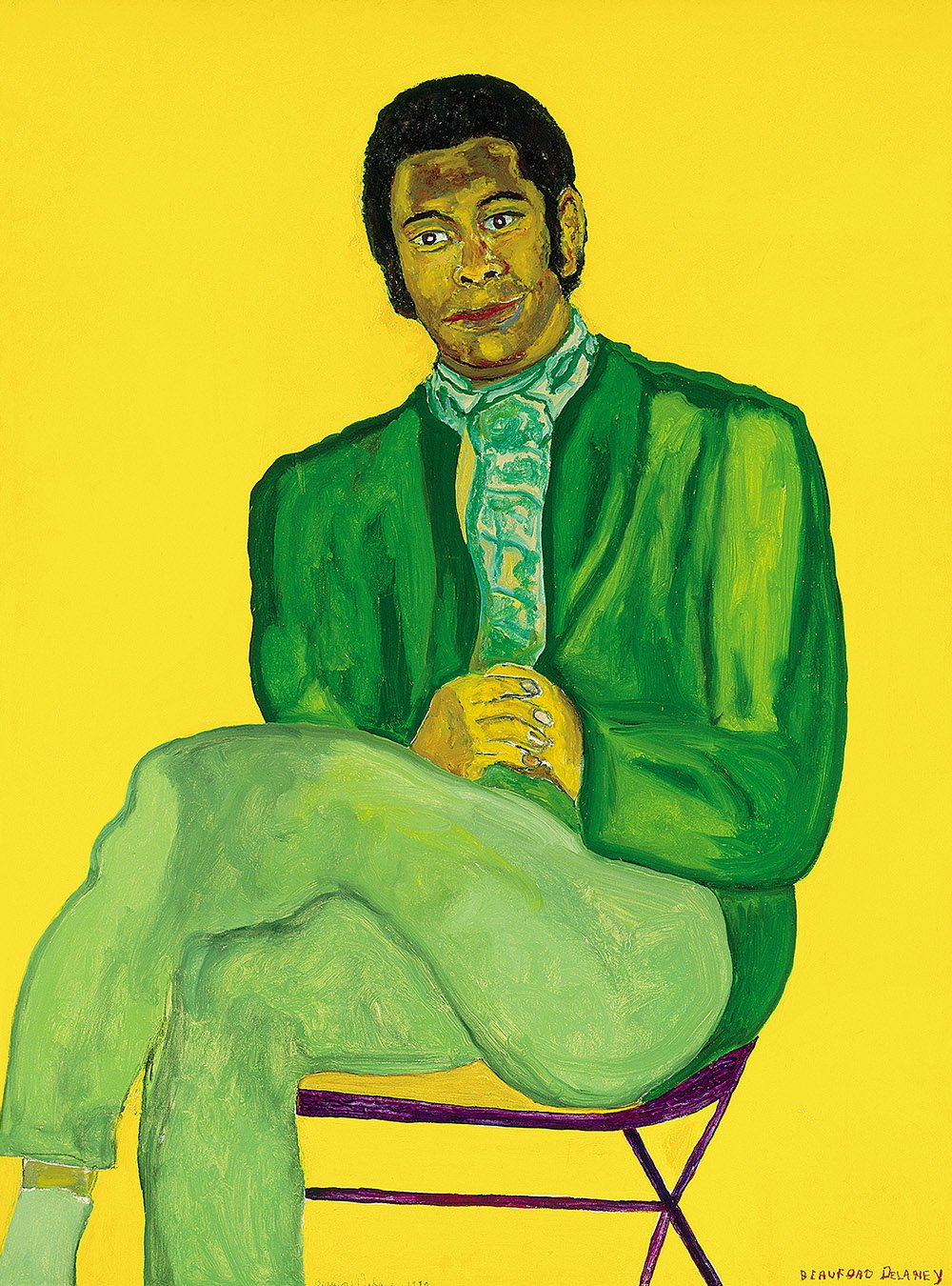 A portrait of a black man sitting on a folding chair, his hands clasped on his lap, legs crossed, he wears a green suit with a green scarf tucked neatly in place of a tie, the background field of vibrant yellow reflects onto the highlight of his face